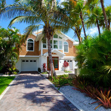Tropical Exterior by Yoder Homes