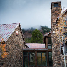 Rustic Exterior by Zone 4 Architects, LLC