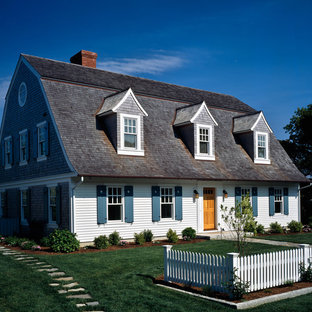 Mid-sized beach style two-story exterior home idea in Boston with a gambrel roof