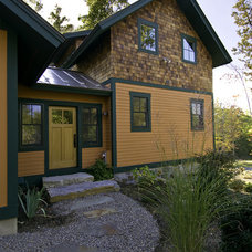 Eclectic Exterior by SAS Builders LLC