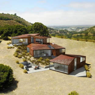 Inspiration for a modern brown metal exterior home remodel in San Francisco with a mixed material roof