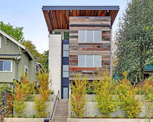 inspiration for a large contemporary multicolored three story mixed siding exterior home remodel in seattle