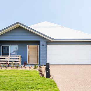 Transitional one-storey blue exterior in Townsville with concrete fiberboard siding and a gable roof.