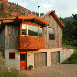 Inspiration for a small rustic gray three-story wood gable roof remodel in Denver