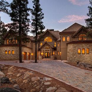 Mountain style stone exterior home photo in Sacramento