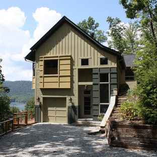 Inspiration for a large rustic green two-story wood gable roof remodel in Charlotte