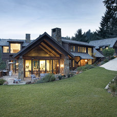 Rustic Exterior by Michael Rex Architects