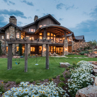 Example of a mountain style brown three-story mixed siding exterior home design in Denver