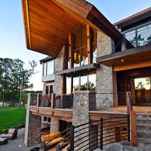 Источник вдохновения для домашнего уюта: огромный, трехэтажный дом в современном стиле с облицовкой из камня