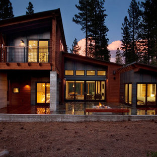 Trendy wood exterior home photo in Sacramento
