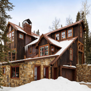 Large mountain style brown three-story mixed siding exterior home photo in Denver with a metal roof