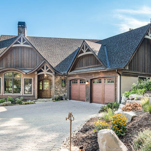 Example of a large mountain style brown two-story mixed siding exterior home design in Other with a shingle roof
