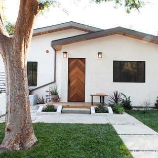 Danish white one-story gable roof photo in Los Angeles