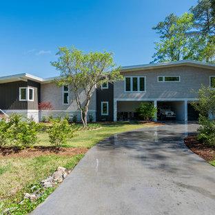 Diseño de fachada de casa multicolor, ecléctica, de tamaño medio, a niveles, con revestimientos combinados y tejado a dos aguas