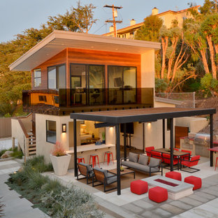 Trendy two-story mixed siding exterior home photo in San Diego with a shed roof