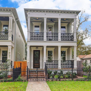 Mid-sized victorian gray two-story mixed siding exterior home idea in Houston with a shingle roof