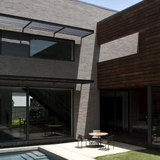 Modern Exterior by Workshop M Architecture