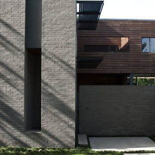 Minimalist brick exterior home photo in Houston