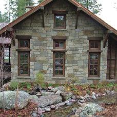 Rustic Exterior by Montana Rockworks, Inc