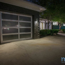 Midcentury Exterior by Muve Real Estate
