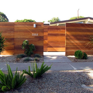 Inspiration for a midcentury modern exterior home remodel in Orange County