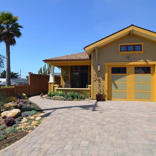 Inspiration for a small craftsman yellow exterior home remodel in Dallas