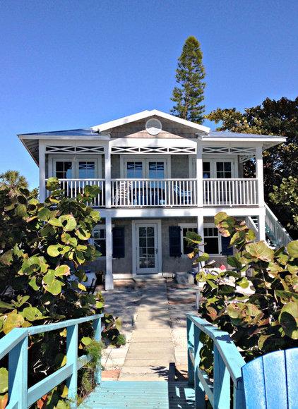 Beach Style Exterior by Mina Brinkey