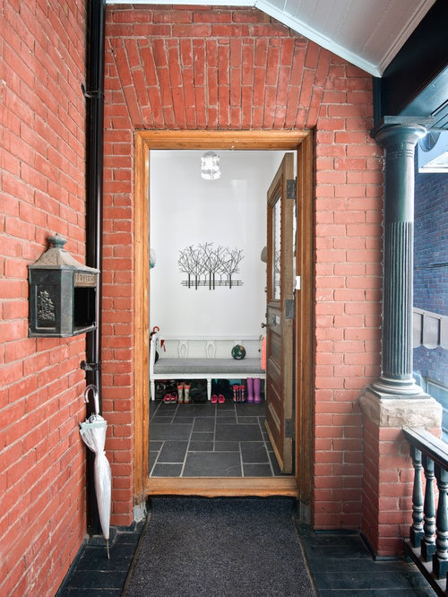 Example Of A Small Transitional Red Brick Exterior Home Design In Toronto