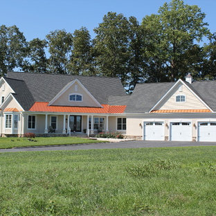 Example of a mid-sized farmhouse beige one-story stucco exterior home design in Other with a mixed material roof