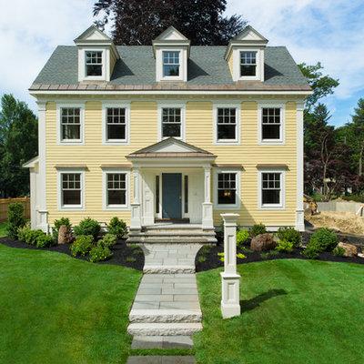 Elegant yellow exterior home photo in Boston