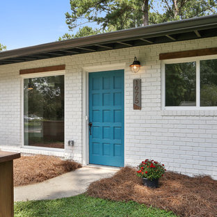 This is an example of a large midcentury white exterior in Atlanta.