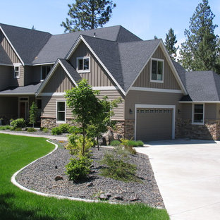Mid-sized transitional brown two-story concrete fiberboard gable roof idea in Seattle