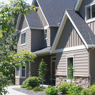 Mid-sized transitional brown two-story concrete fiberboard gable roof photo in Seattle