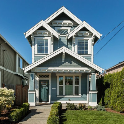Transitional blue two-story wood exterior home idea in Portland