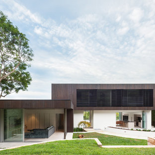 Photo of a brown modern two floor exterior in Sydney with mixed cladding and a flat roof.
