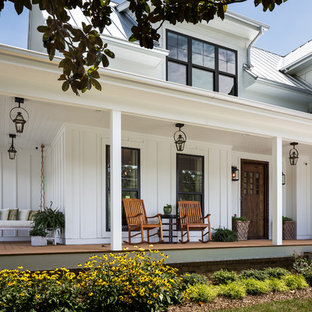 Inspiration for a mid-sized cottage white two-story wood exterior home remodel in Nashville
