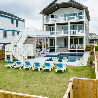 Inspiration for a mid-sized beach style white three-story wood exterior home remodel in Other with a shingle roof