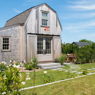 Inspiration for a cottage gray two-story wood house exterior remodel in Boston with a gambrel roof and a shingle roof