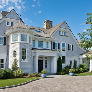Huge victorian three-story wood exterior home idea in Boston