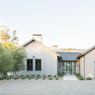 Farmhouse white one-story exterior home idea in San Francisco with a metal roof