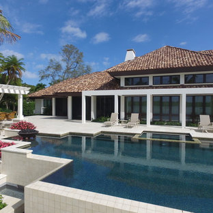 Tuscan white house exterior photo in Other with a tile roof