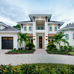 Inspiration for a modern beige two-story exterior home remodel in Miami