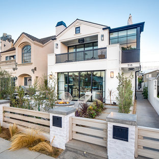Inspiration for a beach style white two-story gable roof remodel in Los Angeles