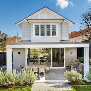 Inspiration for a mid-sized beach style two-storey grey house exterior in Sydney with a gable roof, a metal roof and mixed siding.