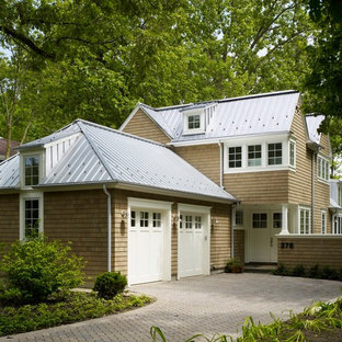 Inspiration for a mid-sized timeless beige three-story wood gable roof remodel in Chicago
