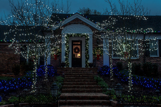 Traditional Exterior by Light Up Nashville