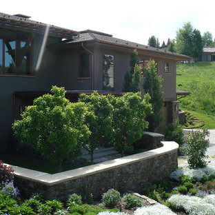 Mid-sized transitional gray two-story mixed siding exterior home idea in Boise with a shingle roof