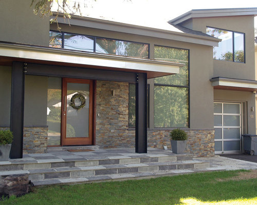large modern twostory stone exterior home idea in toronto