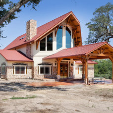 Rustic Exterior by Texas Timber Frames