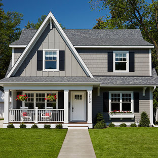Mid-sized transitional gray two-story wood gable roof idea in Minneapolis